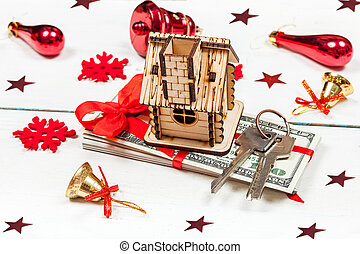 House, keys and a stack of banknotes