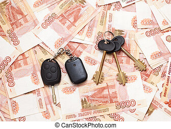 House keys and car key on cash