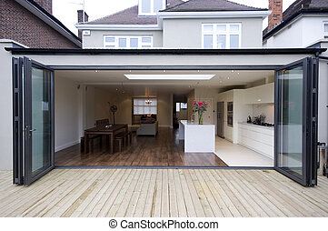 An outside view of an kitchen extension.