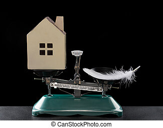 house lighter than a feather on black concept of house worthless