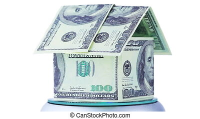 house made from dollar bills spinning, they with inscription souvenir