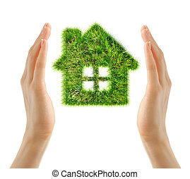 House made of grass in female hands