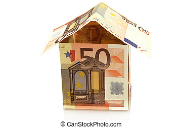 House made of money on a white background