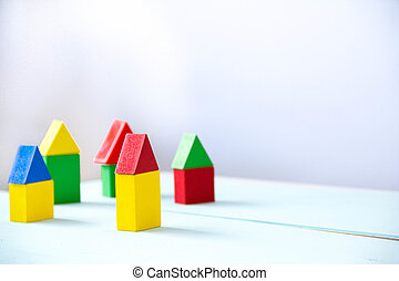 House made of old cubes. Wooden colorful building blocks. Vintage childrens toys. the concept of building a house, apartments for sale