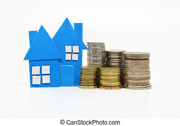 House model and stacks of coins