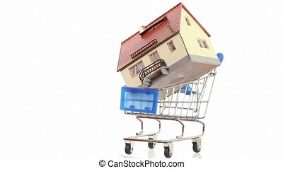 House model inside little shopping cart turning around on platform