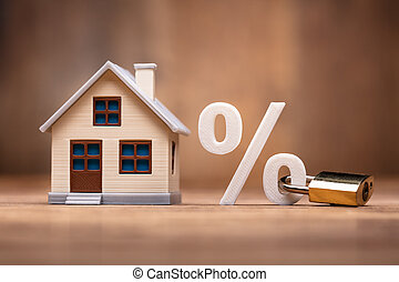 House Model Near Percentage Sign With Keypad Lock