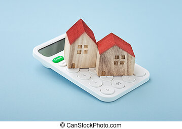 House model on calculator, home mortgage and finance concept