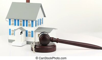 House model with a hammer and a key isolated on a white...