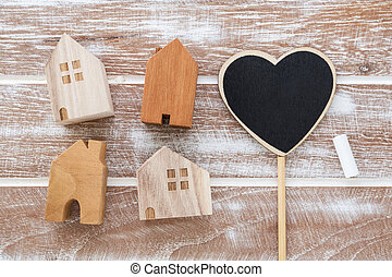 House model with heart sign