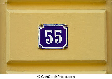 Number Fifty-five - House Number Fifty-five sign at a yellow...