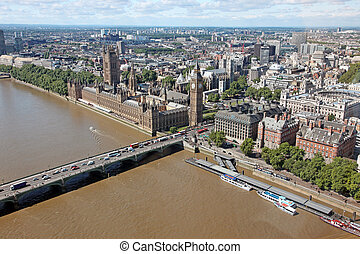 House of Parliament with Big Ben tower with Thames river in London, view from London Eye, UK