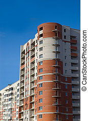 House of red and white bricks - High multistory house of red...