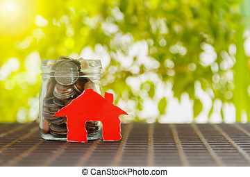 House on a pile of money,house with coins on background,finance concept,business background,money content and selective focus.