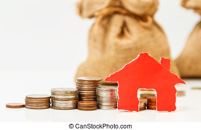 House on a pile of money,house with coins on white background,finance concept,business background,money content and selective focus.