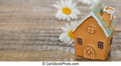 House on a wooden background