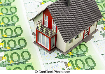 house on banknotes - house on bills, symbolic photo for home...