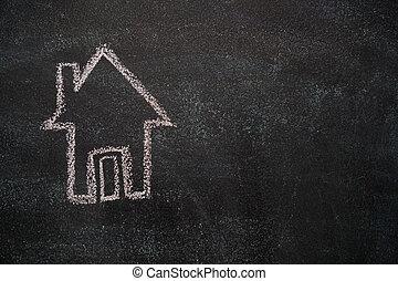 House on black chalkboard