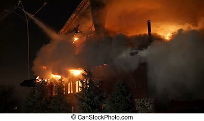 House building on fire at night. Inferno conflagration.
