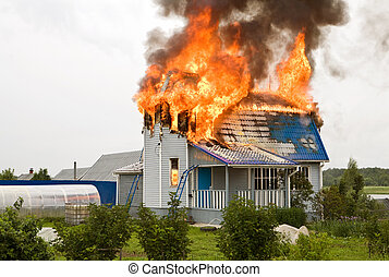 house on fire - Wooden house on fire