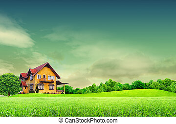 House on green field landscape with blue sky