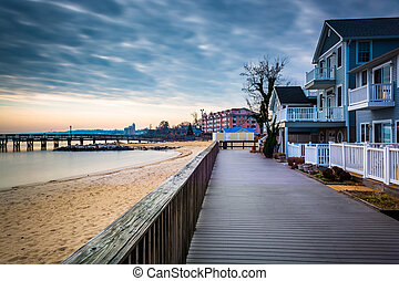 House on the boardwalk and the shore of the Chesapeake Bay,...