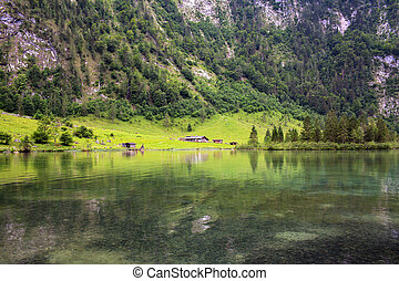 House on the shore of a large Konigssee Lake with in Alps