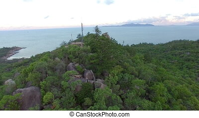 House on top of a rock and forest aerial shot