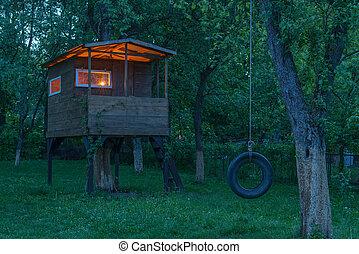 house on tree in evening garden