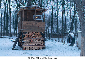 house on tree in winter garden