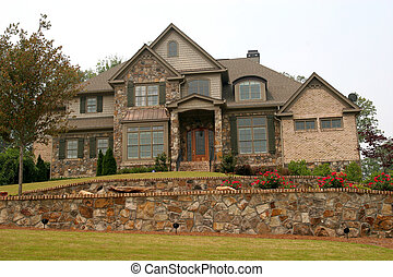 House over Stone Wall