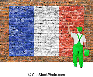 House painter covers brick wall with flag of France