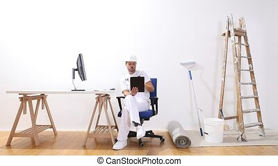 house painter man with computer searches the internet,...