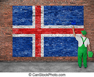 House painter paints flag of Iceland on old brick wall