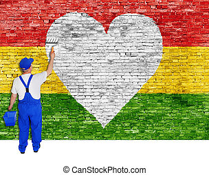 House painter paints heart symbol and flag of Reggae