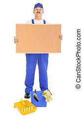 House painter showing empty corkboard