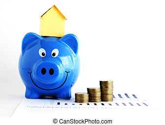 House paper on piggy bank and coins for loans concept