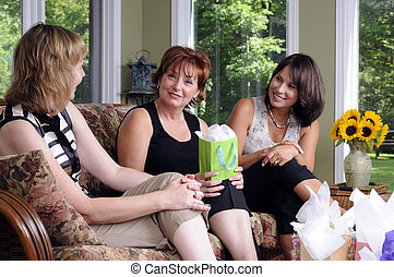 House Party - Three Woman Giving A Surprise Gift To Their...