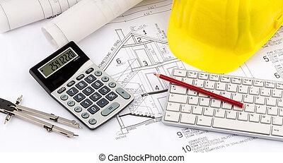 house plan with a construction worker's helmet - a blueprint...