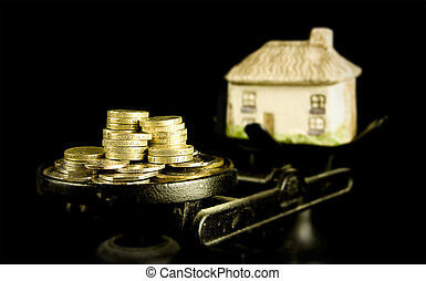 house prices, money and a house on scales