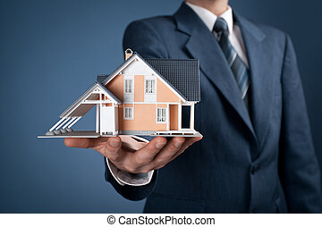 Real estate agent offer house represented by model.