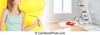 House renovation - Beautiful young lady with painting roller...
