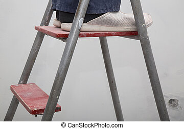 House Renovation. Master on ladder
