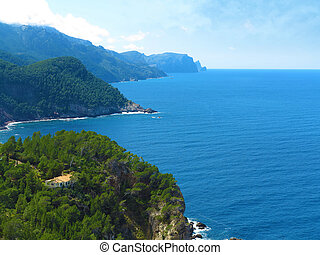 house, rocky coastline and the sea - house in coastal ...