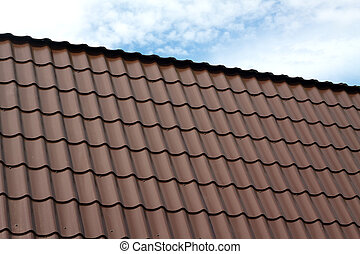 House roof from brown metal tile cl