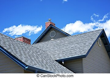 House Roof - Roofing Works. Cloudy Blue Sky. American Building Style.