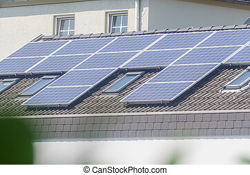 House roof with solar panels - Renovated house, on the roof...