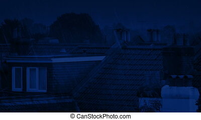 House Rooftops On Rainy Night - Roofs of houses in heavy...