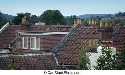 House Rooftops With Trees Moving In Breeze - Generic house...
