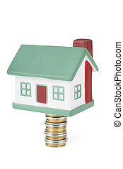 House sale - Little house toy on a stack of coins isolated...